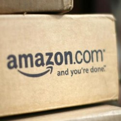 A box from Amazon.com is pictured on the porch of a house in Golden, Colorado in this file photo dated July 23, 2008. REUTERS/Rick Wilking